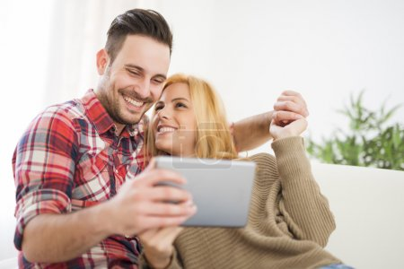 Young couple browsing internet at home