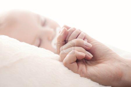 Closeup portrait of cute newborn baby sleeping