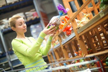 Women choosing bread in shop