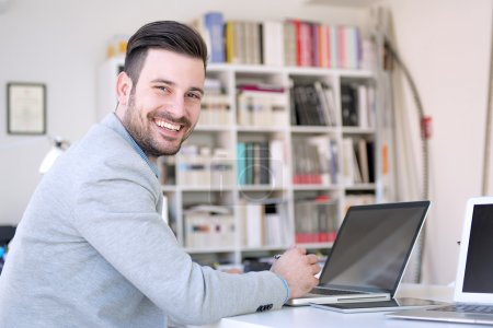 Photo for Businessman working on his laptop in the office.Cropped shot of a young businessman. - Royalty Free Image