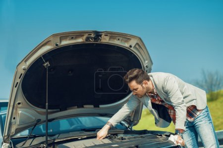 Men having problem with his car