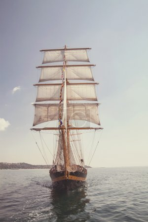 Old historical ship (yacht) with white sails, sailing in the sea