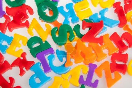 Multicolored plastic letters. Alphabet background