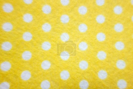pattern with big white polka dots on a yellow background