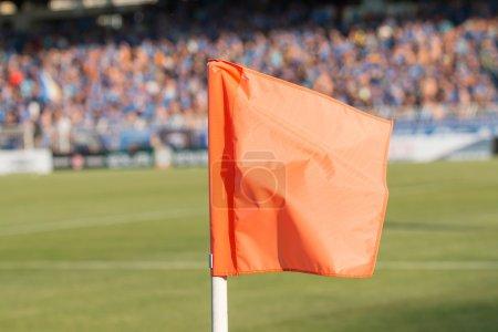 Corner flag on an soccer field during a football mach