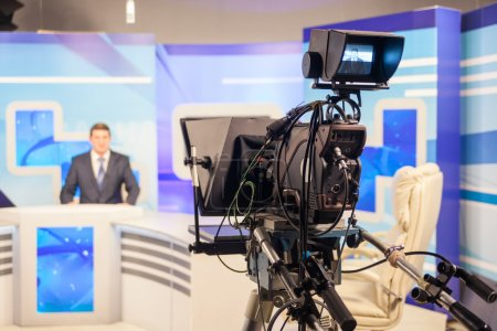Photo for Tv studio camera recording male reporter or anchorman. Live broadcasting - Royalty Free Image