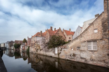 Beautiful houses along the canals of Brugge, Belgium. Tourism destination in Europe