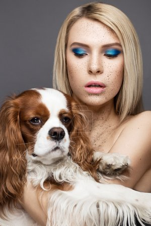 Beauty girl with a perfectly straight hair and a dog. Beauty face