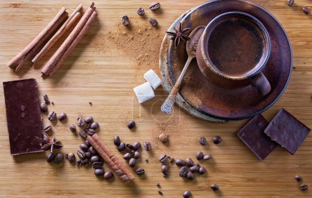 Top view of spiced coffee and spices