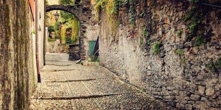 Deserted medieval street - vintage effect. Varenna, Como lake, Italy.
