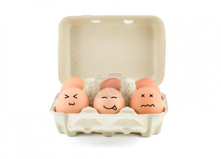 Photo for Funny Drawing Faces on Eggs in carton isolate on white with clipping path - Royalty Free Image