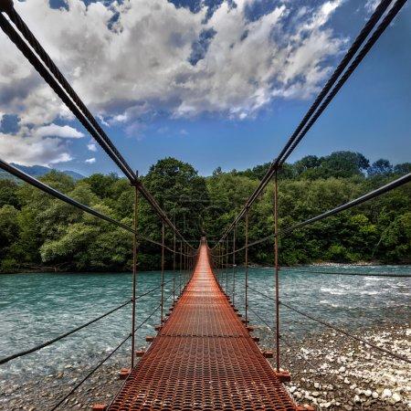 Landscape view of Long Steel Suspension bridge above the river
