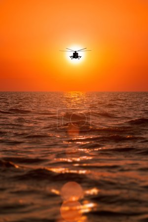 Mi-8 helicopters, warm sunset