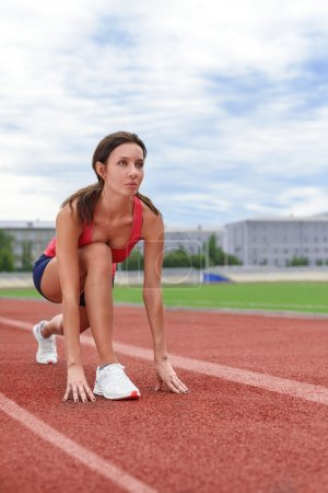 Athlete woman on the starting blocks
