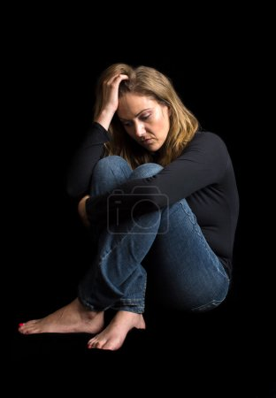 Photo for Woman in a dark room not feeling well - Royalty Free Image