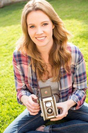 Woman vintage camera