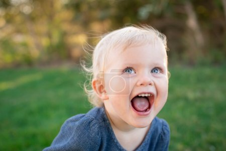 Photo for Cute expressive little girl outside - Royalty Free Image