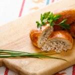 Russian pirozhki (baked patties) on wooden cutboar...
