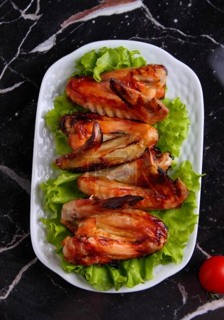 Photo for Fried chicken wings on white plate, top view - Royalty Free Image