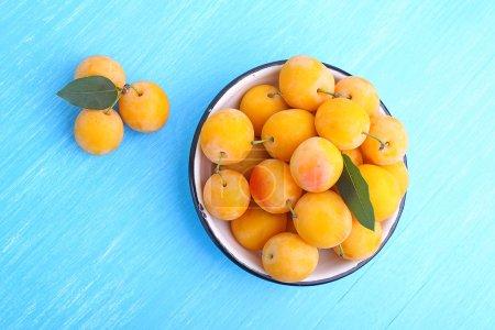 Ripe apricots on wood