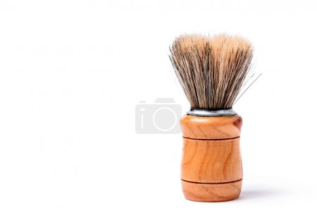 Old shaving brush isolated on white background