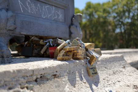 Bunch of padlocks of lovers on the bridge in Rome