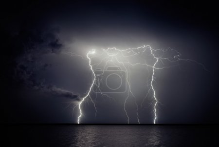 Photo for Lightning storm over the lake at night. - Royalty Free Image