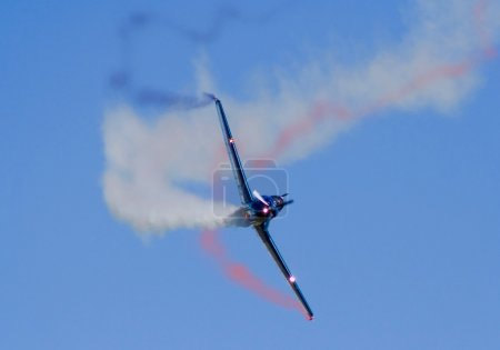 Acrobatic plane doing loops