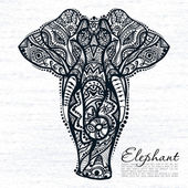 Vector drawing of elephant with ethnic patterns of India On the grunge background