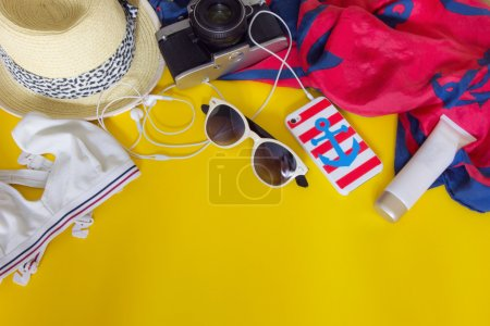 Different objects for traveling on yellow background