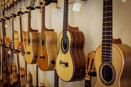Photo for Rows of acoustic guitars on the wall - Royalty Free Image
