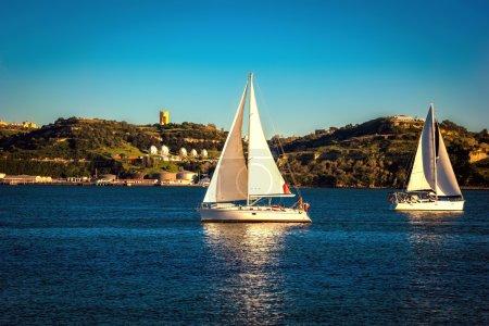 Sailing ship yachts with white sails. Lisbon, Portugal