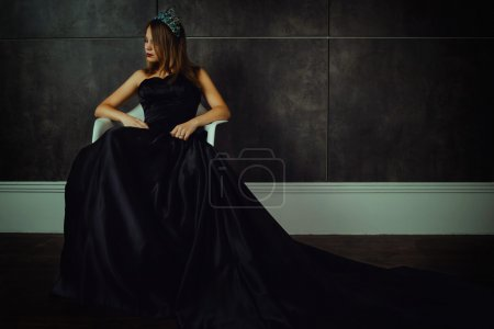 Photo for Fashion beautiful woman in long black dress and diamond crown. Studio shot - Royalty Free Image