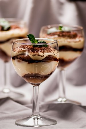 Photo for Italian dessert tiramisu with coffe and cinnamon - Royalty Free Image