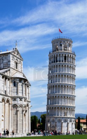 Photo for Leaning tower of Pisa is one of the Italy's famous landmarks. A slant can be easily seen by comparing with the adjacent building. - Royalty Free Image