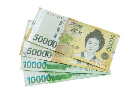 Photo pour Monnaie won sud-coréen sur fond blanc - image libre de droit