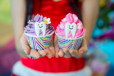 Photo for Giving Fancy cupcakes, holiday - Royalty Free Image