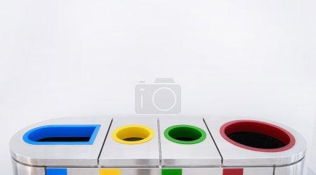 Photo pour Corbeille colorée pour déchets - image libre de droit