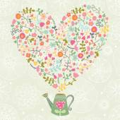Romantic floral background with watering can with flowers and heart