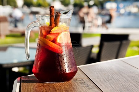 Sangria with red wine in a jug on the boards...