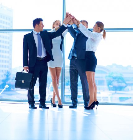 Photo for Business people with their hands together in a circle - Royalty Free Image