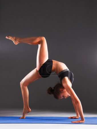 Photo for Portrait of sport girl doing yoga stretching exercise . - Royalty Free Image