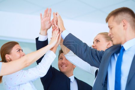 Business team joining hands together