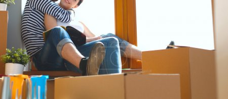 Photo for Portrait of young couple moving in new home. - Royalty Free Image