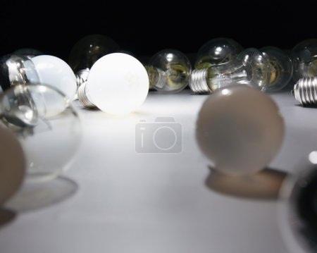 Light bulb lying on the desk