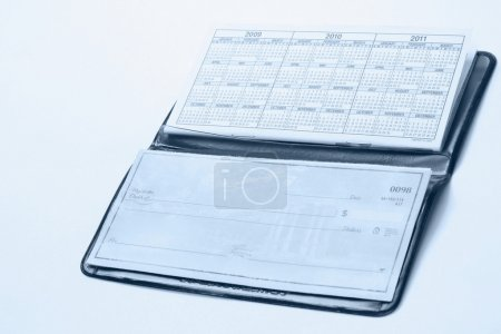 An open checkbook isolated on white