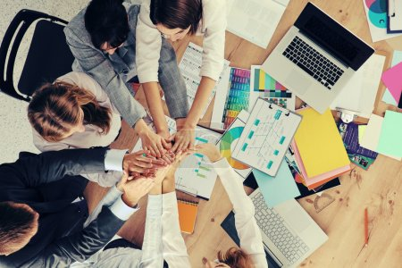 Photo for Business team with hands together - teamwork concepts, isolated - Royalty Free Image