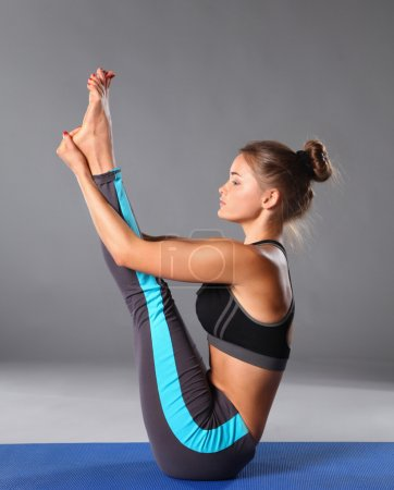 Photo for Portrait of sport girl doing yoga stretching exercise - Royalty Free Image