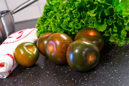 Photo for Spanish tomatoes with lattuce prepared  for cooking - Royalty Free Image