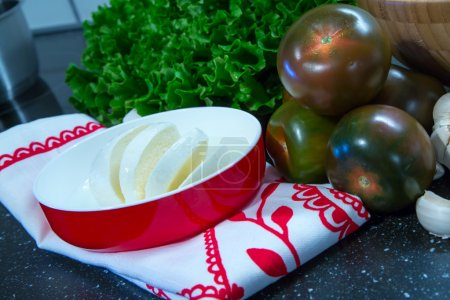 Photo for Mozarella  with tomatoes, lattuce prepared  for cooking - Royalty Free Image